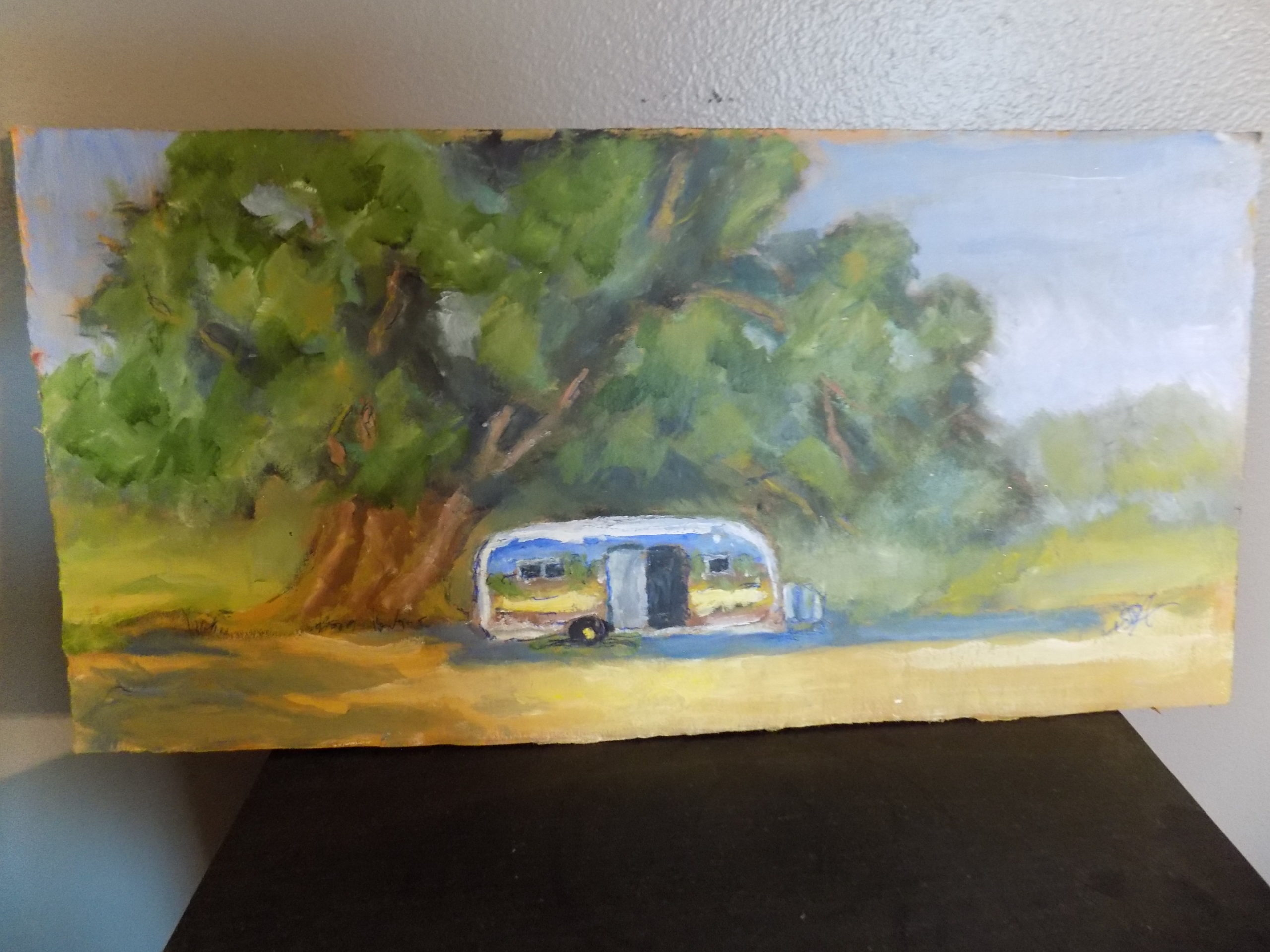painting of travel trailer parked under tree
